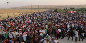 In this photo provided by UNHCR officials and taken on Thursday, Aug. 15, 2013. Syrian refugees cross the border toward Iraq at Peshkhabour border point at Dahuk, 260 miles (430 kilometers) northwest of Baghdad, Iraq.  The UN High Commissioner for Refugees (UNHCR) has set up an emergency transit camp in Irbil, where around 2,000 refugees are camping out and UNHCR officials say some thousands of refugees have been streaming into northern Iraq, many coming across a newly-constructed pontoon bridge over the Tigris River at Peshkhabour. (AP Photo/HO)